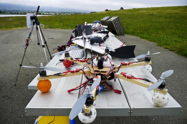 Hi-tech hobbyists Andreas Oesterer and Mark Harrison line up their homemade drones in Berkeley, Calif.