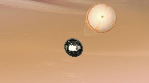 <p>A parachute more than 50 feet across pops out, adding a bit more braking as the craft sinks into Mars's lower atmosphere.</p><p></p><p></p>