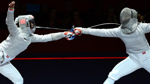 Russia's Sofya Velikaya (left) fences against South Korea's Kim Ji Yeon in their sabre gold medal bout Wednesday. Because of a limit on medals, there is no women's team sabre title at the London 2012 Games.