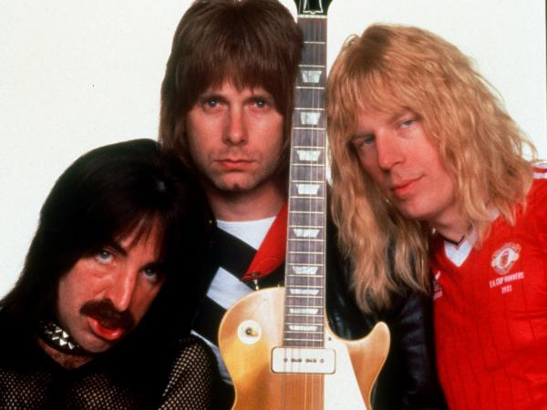 Harry Shearer (left), Christopher Guest (center) and Michael McKean play the British band Spinal Tap, created for Rob Reiner's 1984 mock rockumentary <em>This Is Spinal Tap</em>.
