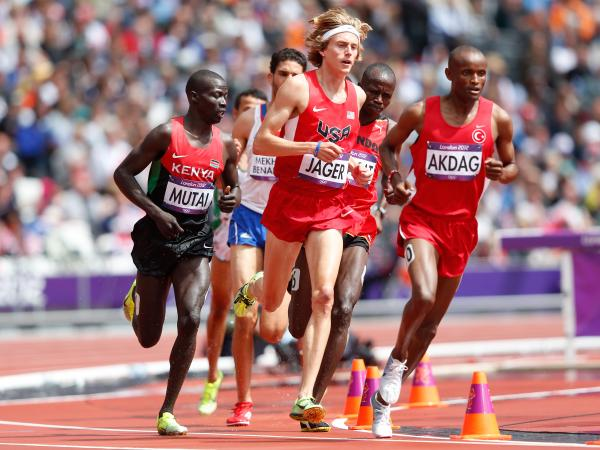 Evan Jager of the United States and Tarik Langat Akdag of Turkey lead their men's 3000m steeplechase heat, on Day 7 of the London 2012 Olympic Games.