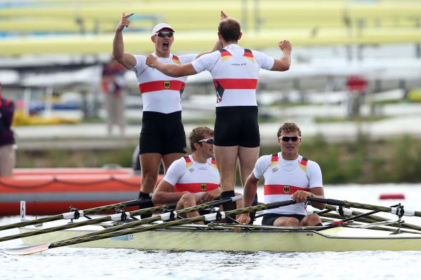 Karl Schulze, Phillipp Wende, Lauritz Schoof and Tim Grohmann of Germany celebrate winning gold in the men's quadruple sculls final.