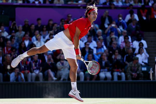 Roger Federer of Switzerland returns a shot in the third set against Juan Martin Del Potro of Argentina in the semifinal of men's singles tennis. Federer won the match, which took more than 4 hours to play.