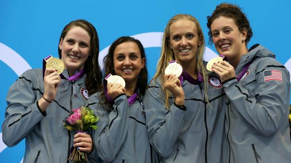 U.S. gold medallists (L-R) Missy Franklin, Rebecca Soni, Dana Volmer, and Allison Schmitt pose on the podium after their world-record 4x100m medley relay final.