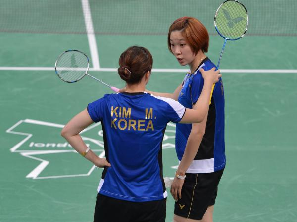 South Korea's Kim Min Jung (left) and Ha Jung Eun were among the players disqualified for not trying hard enough.