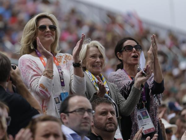 Rafalca's owners, Ann Romney (from left), Elisabeth Meyer and Amy Eberling, applaud after their horse's performance in the equestrian dressage competition at the Summer Olympics on Aug. 2.