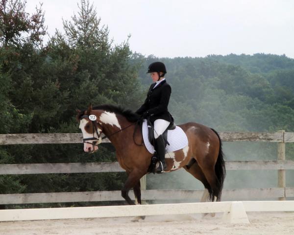 College student Celia Rozanski rides Jasper at a horse show sponsored by the Potomac Valley Dressage Association.