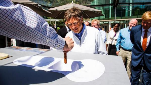 Bill Gates, co-founder of the the Bill & Melinda Gates Foundation, checks out a toilet demo at the Reinvent the Toilet Fair in Seattle, Wash. The festival featured prototypes of high-tech toilets developed by researchers around the world.