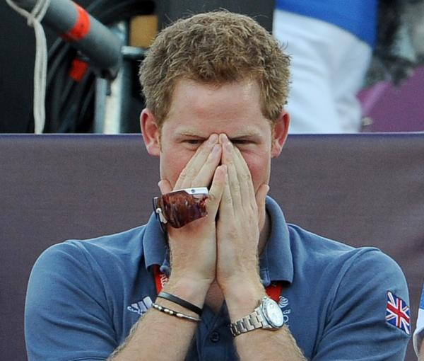Prince Harry, fully clothed, watching a beach volleyball match at the Olympic Games in London on Aug. 8.