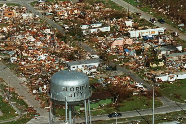A water tower stands over the ruins of the coastal community of Florida City. Two decades later, Florida City and nearby Homestead have doubled in size.