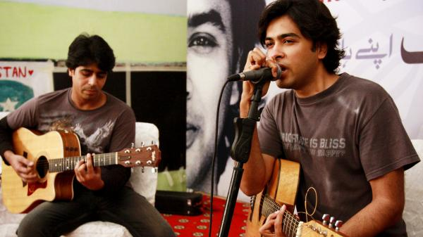 Pakistani pop singer Shehzad Roy (right) sings for teenage prisoners at a prison in Karachi, Pakistan, in 2008. Known originally for fluffy pop songs, Roy's music has taken a harder, more political edge, protesting injustice in Pakistan.