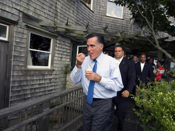Republican presidential candidate Mitt Romney eats ice cream from Millie's on the run before a fundraising event earlier this month in Nantucket, Mass.