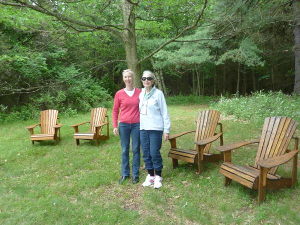 Augsbury (right) stands with her daughter, Abby Howard-Smith Rand, next to the chairs she relaxes in, just feet away from the gravesites of two husbands.