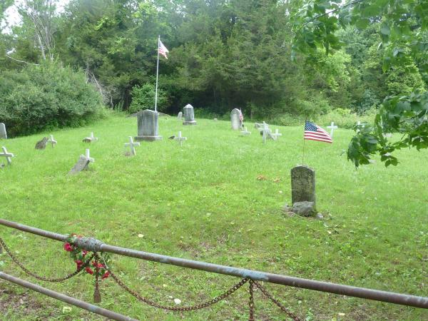 This communal plot in Grindstone Cemetery is well-maintained. But it holds only a portion of the island's graves.