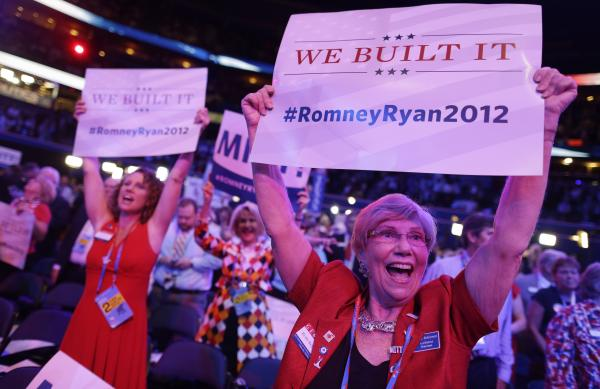 Georgia delegates Ruby Robinson (right) and Kathy Noble hold signs and cheer during the Republican National Convention in Tampa, Fla., where a parade of female officials and officeholders appeared on stage Tuesday.