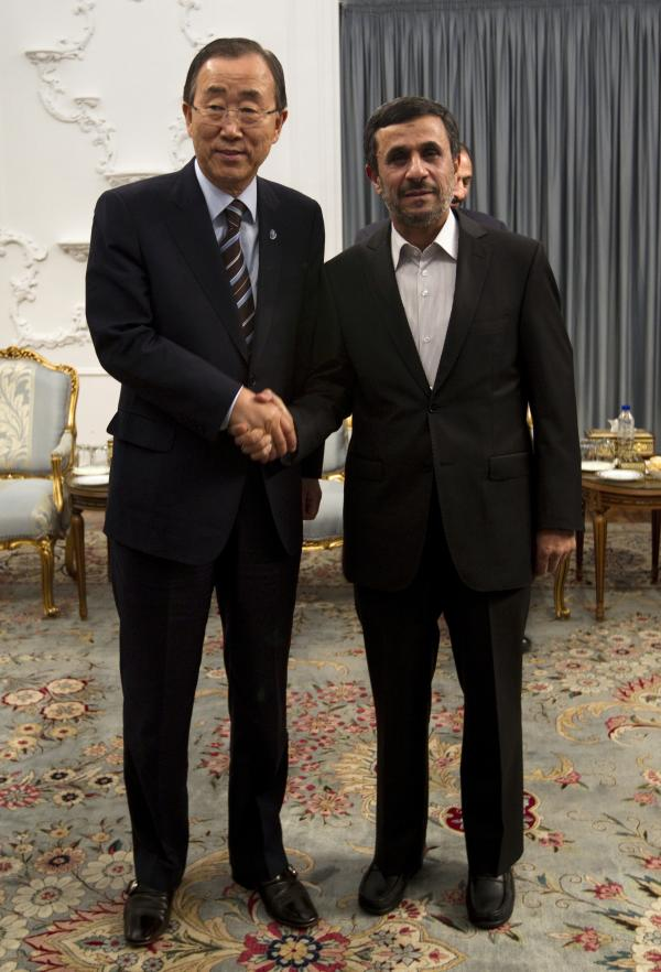 U.N. Secretary-General Ban Ki-moon (left) and Iranian President Mahmoud Ahmadinejad hold talks at the Iranian president's office in Tehran on Wednesday.