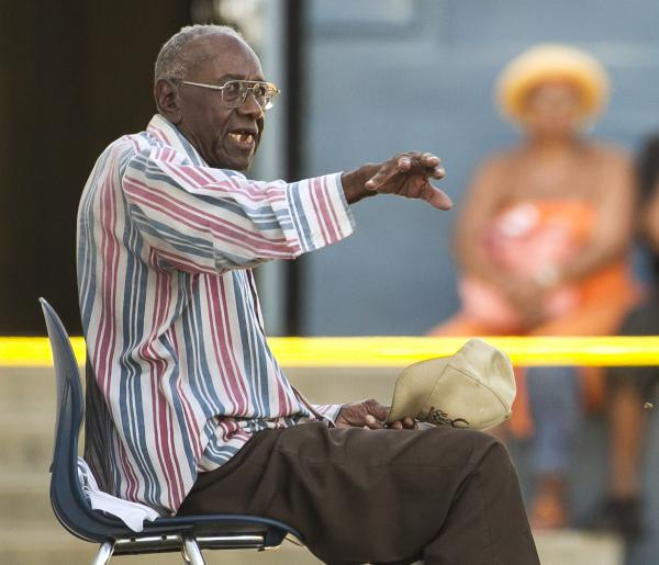 Senior driver Preston Carter, 100, talks with police officers after police say his car went onto a sidewalk and plowed into a group of parents and children outside a South Los Angeles elementary school on Wednesday.