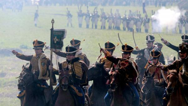 Members of historical clubs, dressed as Russian cavalry, advance during the 2010 re-enactment of the 1812 battle between Napoleon's army and Russian troops in Borodino.