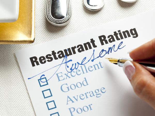 One sign that a restaurant review is a fake is if it gives a very high or very low rating without many specifics.