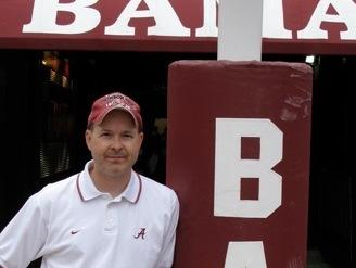 Monique Fields, an unofficial, unpaid football assistant, snapped this picture of her husband, Ken, standing at the goalpost at Bryant-Denny Stadium.