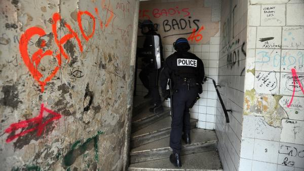 Police climb the stairs in a building on the north side of Marseille, southern France, as part of an operation in January against drug dealing and gun proliferation.