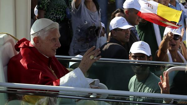 Pope Benedict XVI waves to Lebanese faithful upon his arrival to hold a mass on the waterfront in downtown Beirut on Sunday.