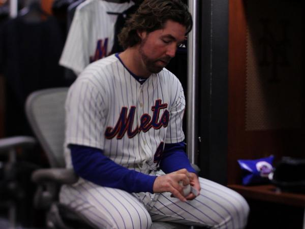 Pitcher R.A. Dickey sits in the Mets' locker room in the film <em>Knuckleball!</em>