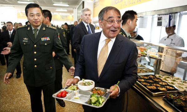 U.S. Defense Secretary Leon Panetta has lunch with engineering cadets at the Chinese military academy in Beijing on Wednesday. Just before Panetta's arrival for talks with top leaders, China released photos of a new stealth fighter under development.