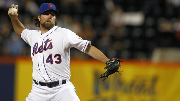 R.A. Dickey of the New York Mets pitches against the Washington Nationals during a game at Citi Field in New York.