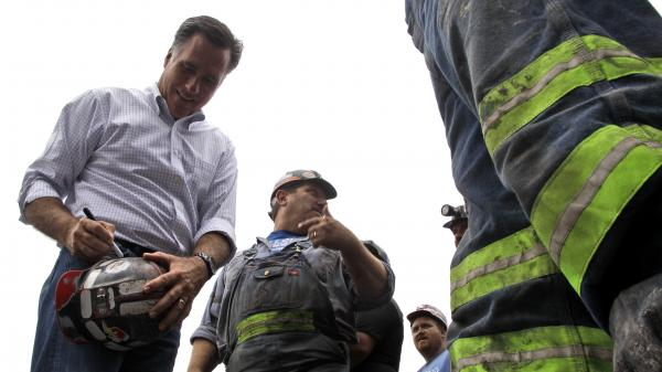 Republican presidential candidate Mitt Romney autographs a coal miner's hat during a campaign event Aug. 14 at American Energy Corp. in Beallsville, Ohio.