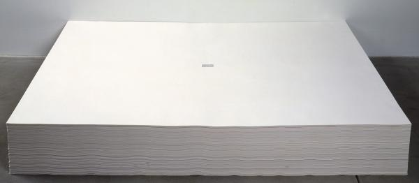 Felix Gonzalez-Torres' untitled 1991 work consists of a stack of papers, each with a tiny excerpt from <em>The New York Times</em> printed in the center. Visitors are invited to take a piece of paper from the work home with them.