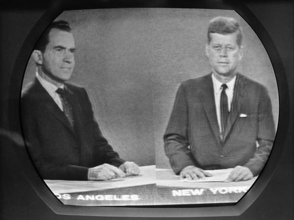 Vice President Richard Nixon listens as Sen. John F. Kennedy talks during their televised presidential race debate. This photo was made from a television screen in New York, Oct. 21, 1960.