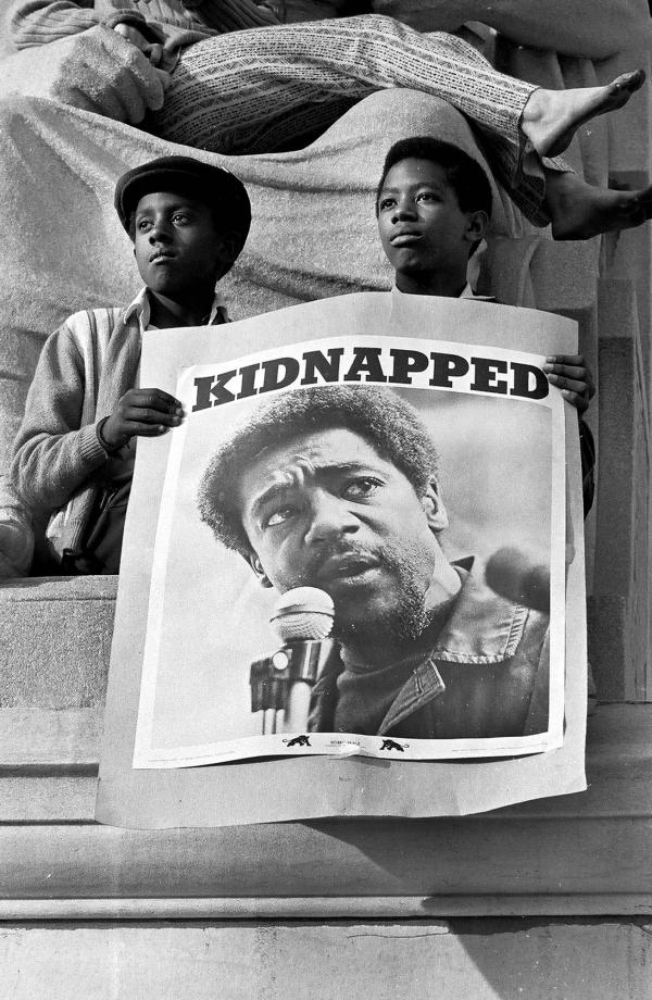 Two young men are shown at a May 1, 1970, rally in support of Black Panther Party Chairman Bobby Seale and other Panthers in New Haven, Conn., who were being tried for the murder of a fellow Panther who confessed to being a police informant.