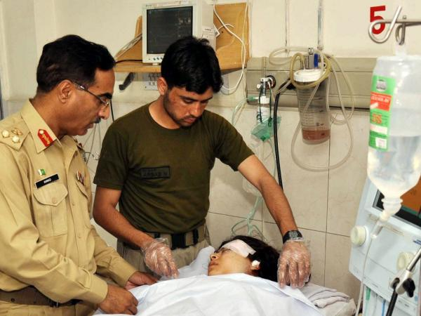 Malala Yousafzai is treated in a hospital in Peshawar, Pakistan, after she was shot on Tuesday.