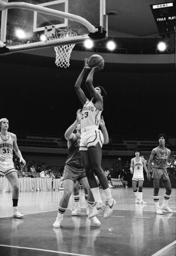 Obama shoots the ball while playing for the Punahou School basketball team in 1979.