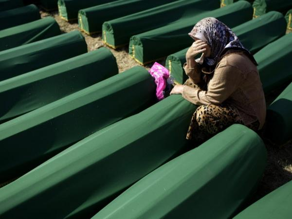 July 11, 2012: A woman cried next to the coffin of her relative at the Potocari memorial complex near Srebrenica. More than 8,000 Muslim men and boys were executed there in July 1995. It was the worst massacre in Europe since World War II.