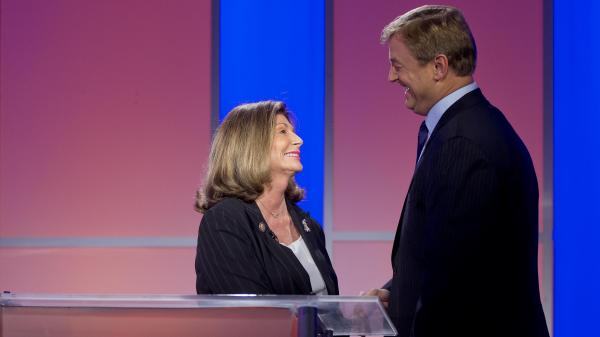 Democatic Rep. Shelley Berkley greets Republican Sen. Dean Heller before the second of their three debates, on Oct. 11 in Las Vegas.