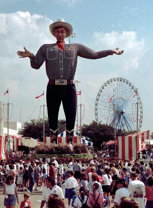 Big Tex watches over the crowd at one end of the State Fair of Texas midway in 1997, in Dallas.