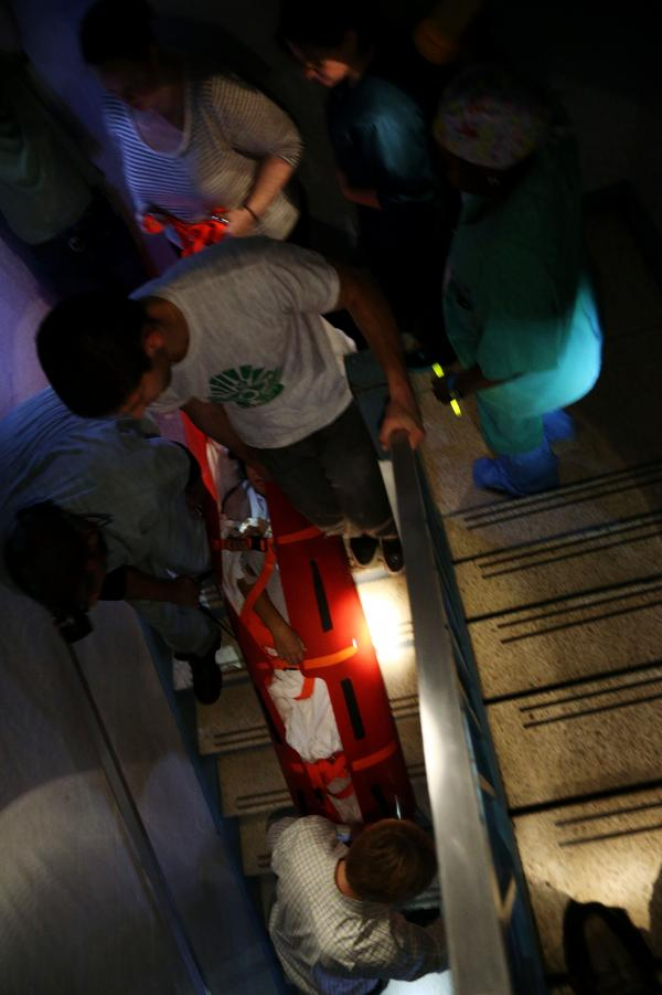 Hospital workers evacuate patient Deborah Dadlani from NYU Langone Medical Center in New York City on Monday.