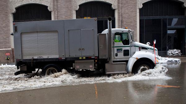 A truck drives through a flooded street caused by Hurricane Sandy in New York City's Financial District on Tuesday.