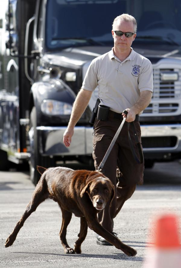 Miami-Dade Detective Douglas Bartelt and narcotics detector canine Franky give a demonstration in Miami in 2011.