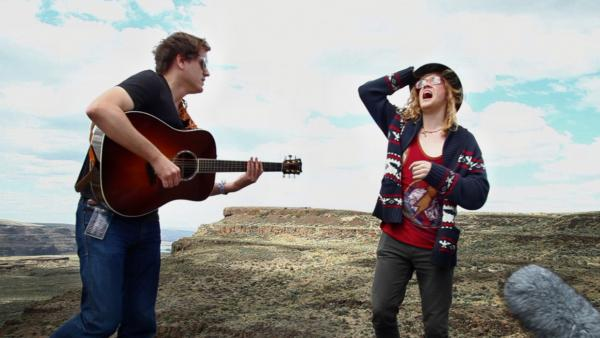 Allen Stone, right, accompanied by Trevor Larkin perform for a Field Recordings video backstage at Sasquatch! Music Fest