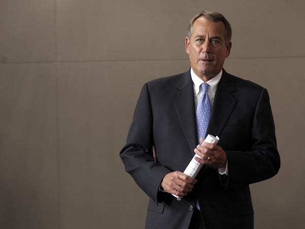 House Speaker John Boehner arrives for a news conference on Capitol Hill on Friday.