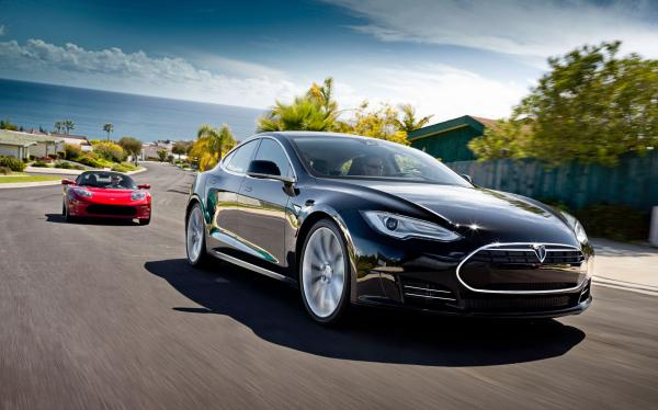 Model S Alpha, in black, and the Telsa Roadster behind it.