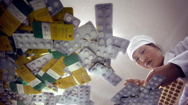 A controversial pilot project reduced the cost of the most effective malaria drugs by giving manufacturers, such as Guilin Pharmaceutical in China, subsidies.