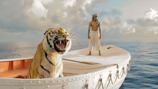 Pi Patel (Suraj Sharma) and a fierce Bengal tiger named Richard Parker must rely on each other to survive an epic journey in <em>Life of Pi</em>.