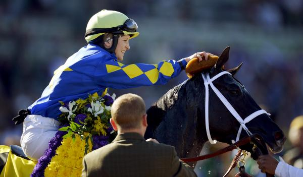 Jockey Rosie Napravnik sponges off Shanghai Bobby after winning the Breeders' Cup Juvenile horse race at Santa Anita Park in Arcadia, Calif.