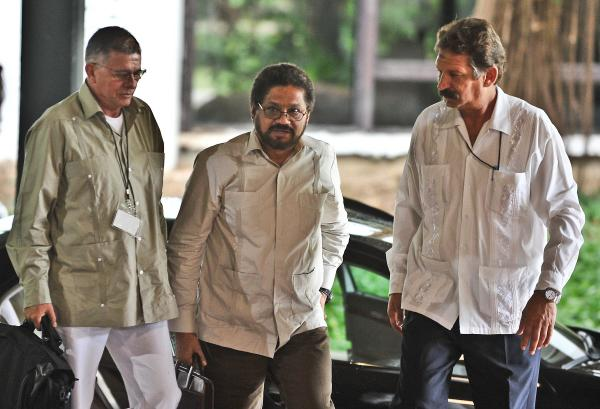 Colombian members of FARC, commanders Ivan Marquez, center, and Rodrigo Granda, left, arrive at Convention Palace in Havana for the peace talks with the Colombian government on Monday.