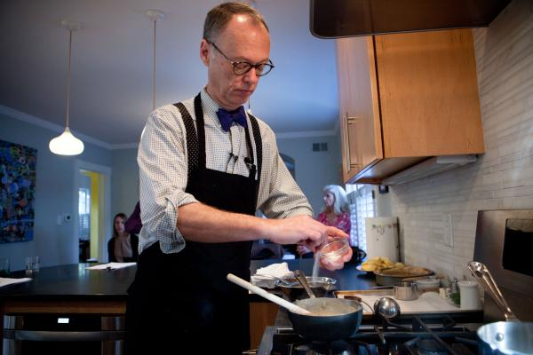 Chris Kimball of <em>America's Test Kitchen</em> adds salt to the roux he's made to add to Julia Child's Puree De Pommes De Terre A L'Ail, or Garlic Mashed Potatoes.