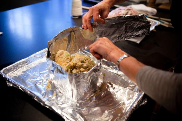 Putting a foil collar around the stuffing creates a base for the turkey breast to rest on and allows both the stuffing and the meat to cook up moist and juicy.